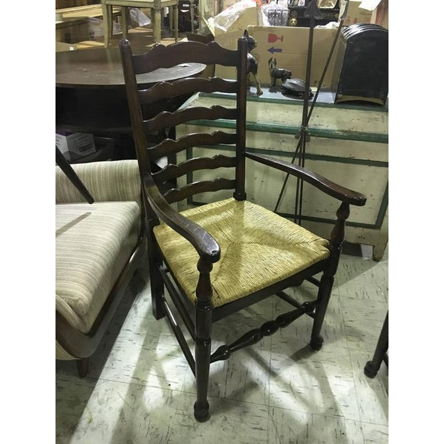 Four english oak ladder back armchairs or two pairs. Lovely deep rich color. Priced per chair.
