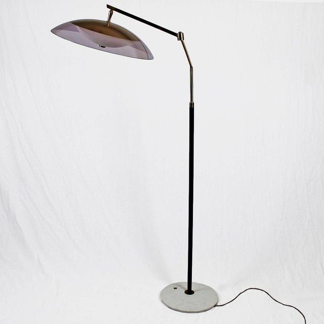 System standing lamp, pivoting and adjustable height, white marble base with switch, black lacquered steel stand, polished...