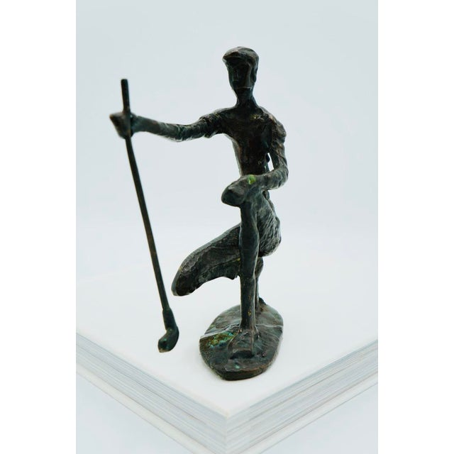 Vintage bronze sculpture of a golfer on a putting green. It's form resembles the style of artist Alberto Giacometti. This...