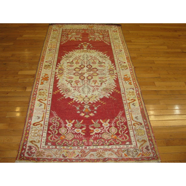 This is a lovely, small, hand-knotted, vintage Turkish rug in rich colors. The rug is in great shape and measures 3' 3'' x...
