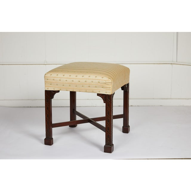 Charming 19th century English carved mahogany stool in the Chinese Chippendale style with four square fretwork carved legs...