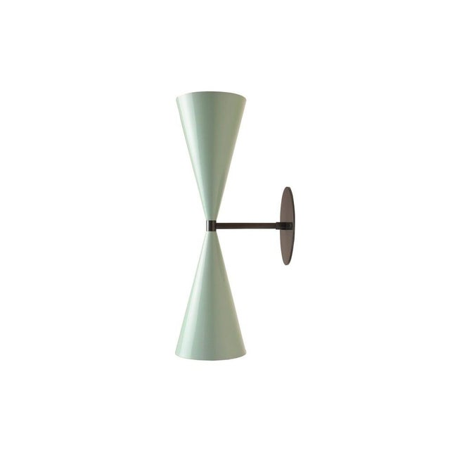The Tuxedo wall sconce or reading light shown in natural brass and high-gloss blood red enamel spun aluminum shades...