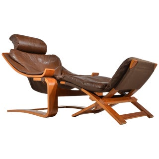 Kroken Teak and Leather Lounge Chair and Stool by Ake Fribytter for Nelo, Sweden For Sale