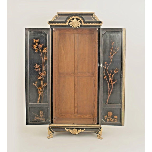 French Victorian (19th-20th century) two-door black lacquered chinoiserie decorated armoire cabinet with bronze trim.