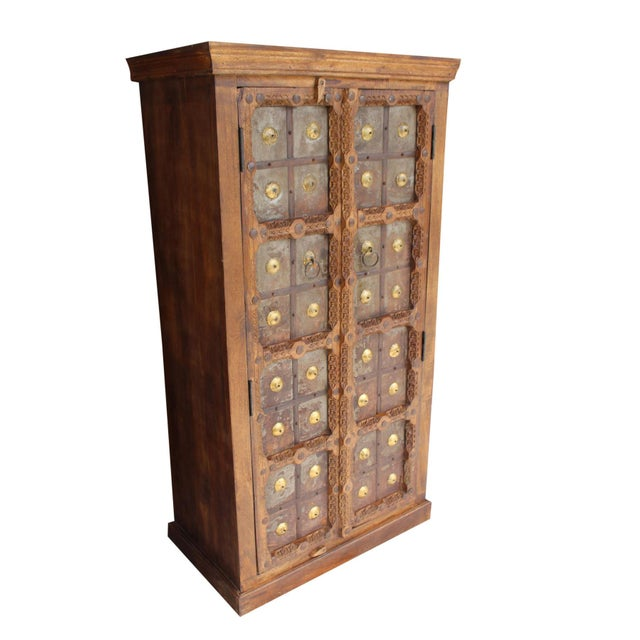 Indian antique hand-carved wooden cabinet with front 2 door three-shelf cabinet for plenty of storage, this is the perfect...