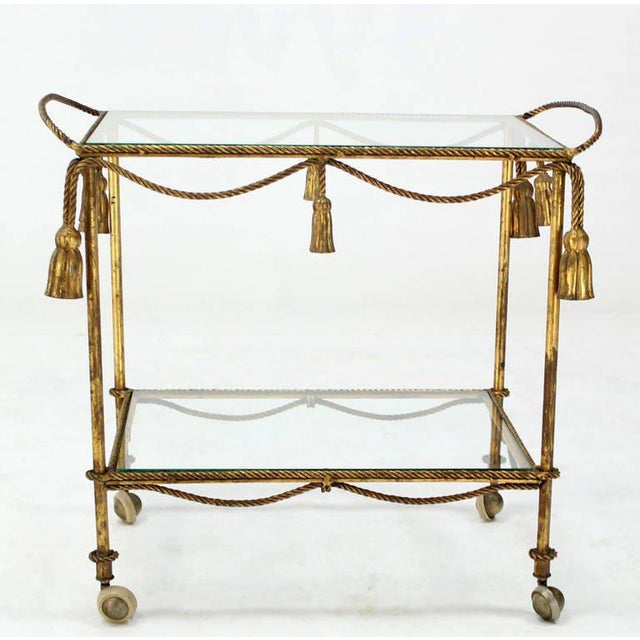 Very nice mid-century modern metal rope tea or bar cart. Nice vintage condition with some patina shown in the pictures.