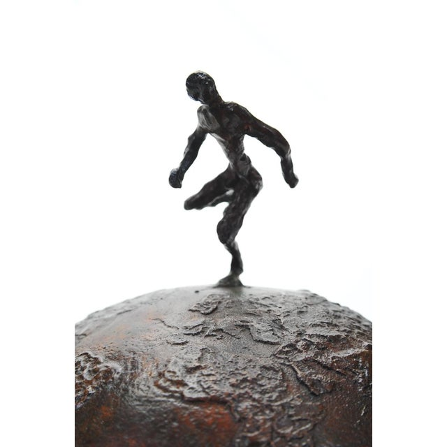 Athlete Running across the World. Abstract tabletop bronze sculpture. A beautiful piece that will add to your décor! Size...