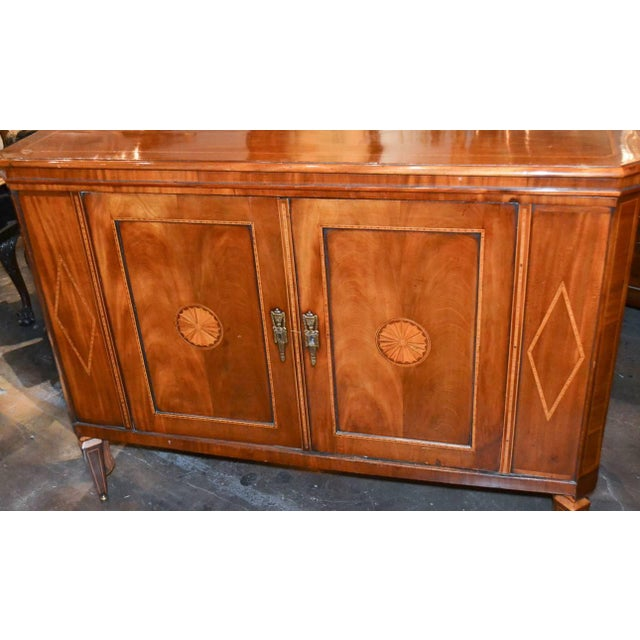 Exceptional English inlaid mahogany two-door server / bar. Having impeccable clean inlays overall, top that reveals...