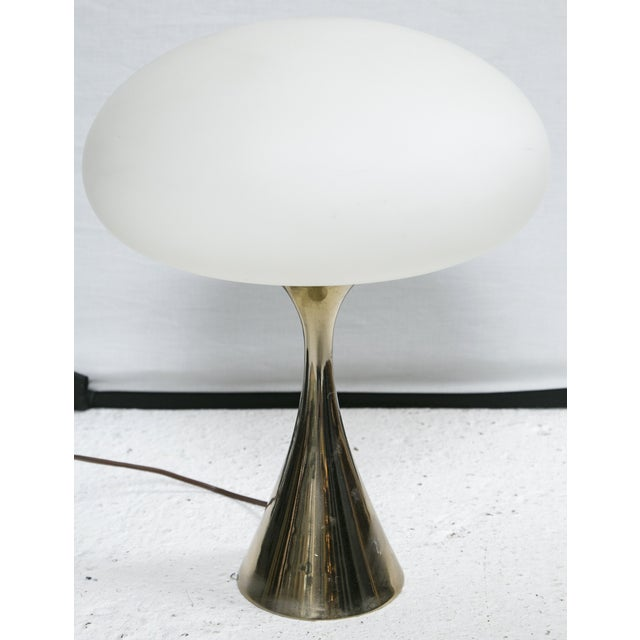 Sexy brass lamp inspired by 70s psychedelia. The Muschroom Lamp designed by Bill Curry for Laurel. Topped off by a...