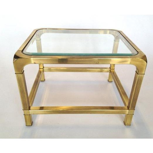 For sale is a pair of brass Mastercraft side tables with beveled edge glass tops. Gorgeous patina, and in a rare low...