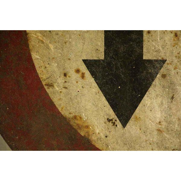 Vintage traffic sign from France. Shows rust and wear from age and use.