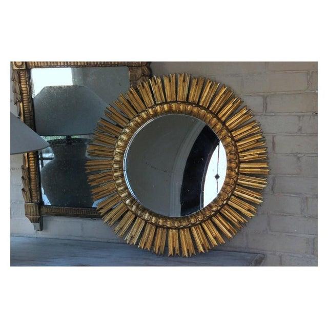 A midcentury French sunburst mirror, circa 1930. Original mirror plate. The mirror is 14 inches in diameter.