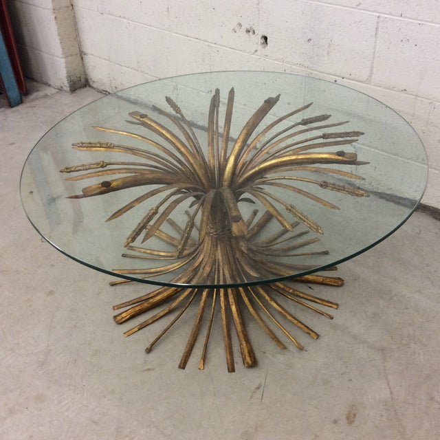 Who doesn't love these tables? Classic Italian gold metal ahead of wheat cocktail table in great condition. Could hold a...