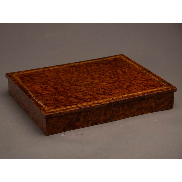 An unusual rectangular table top storage box completely sheathed in extraordinary burl walnut from England c. 1890. Please...