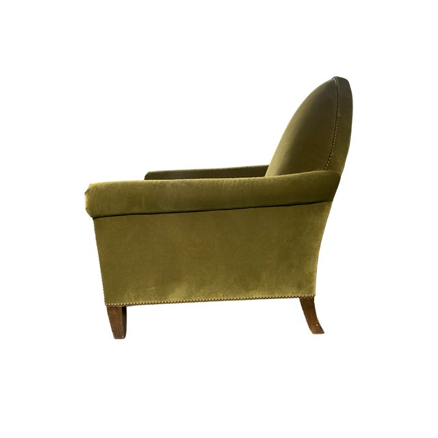 A gothic inspired armchair in soft green velvet with a handsome peak and a custom greige striped seat. The Gothic Chair is...