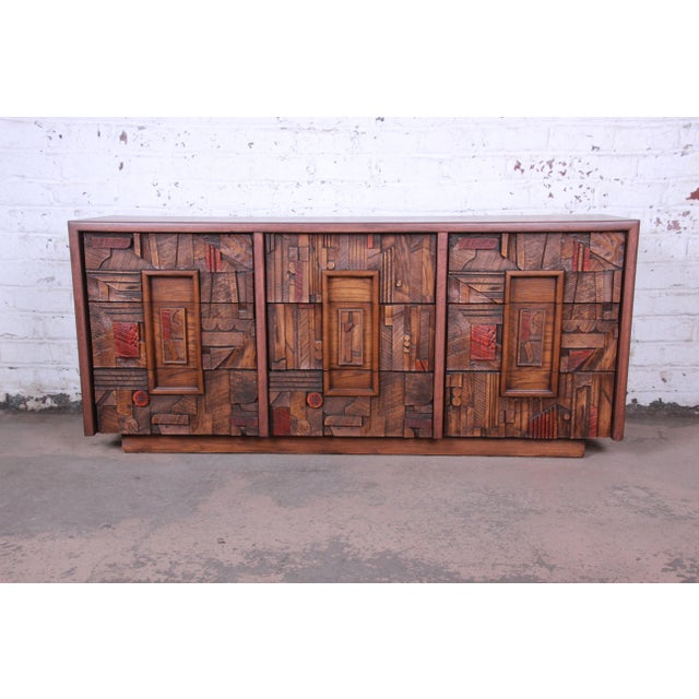 Offering an exceptional mid-century modern brutalist long dresser or credenza from the Pueblo Collection by Lane. The...