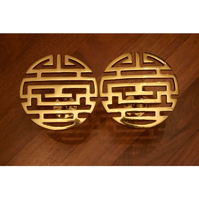 Stunning pair of solid brass drapery tie-backs in a Chinoiserie style. The Chinese symbol represents longevity. These are...
