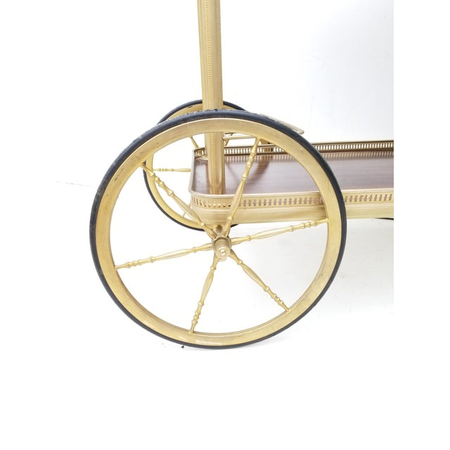 Maison Jansen French Neoclassical Brass Bar cart Runs well , sturdy and solid , wheels in good condition,