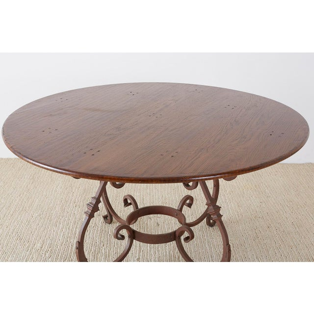 Rustic Italian Oak and Scrolled Iron Round Dining Table For Sale - Image 3 of 13