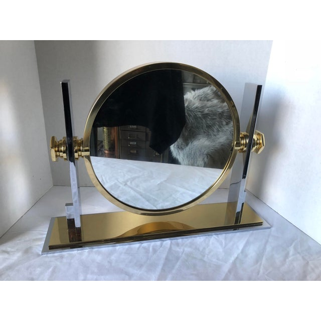 Beautiful Karl Springer vanity mirror. The brass has been polished and is in perfect condition. The last picture shows a...