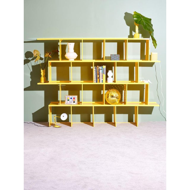 Brand new powder-coated metal shelves by Michael Felix in bright yellow. 4 separate pieces stack to create this large...