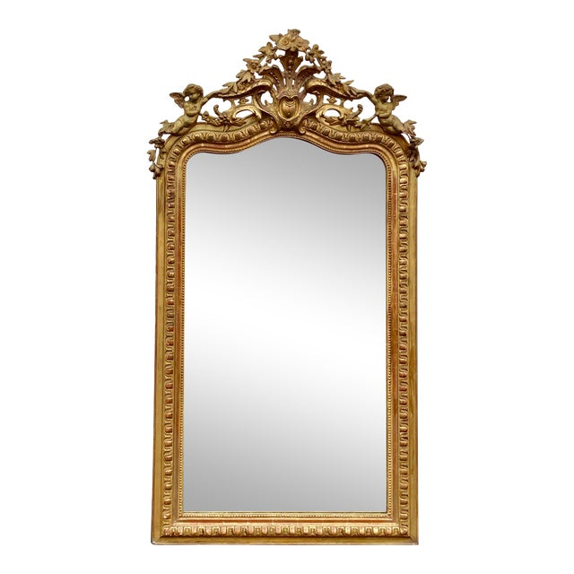 French Giltwood Carved Flowers and Cherub Louis Style Mirror For Sale