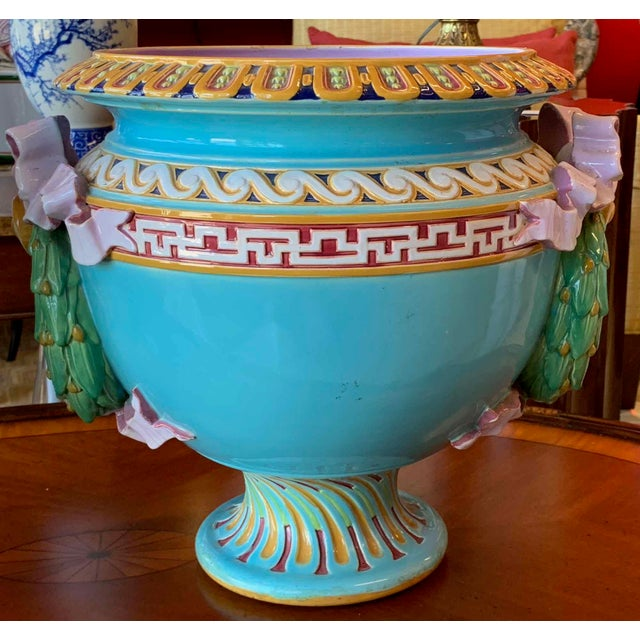 Rare FIND! Pair of antique majolica urns by Minton. We love the luscious colors— robins egg blue and lavender with bright...