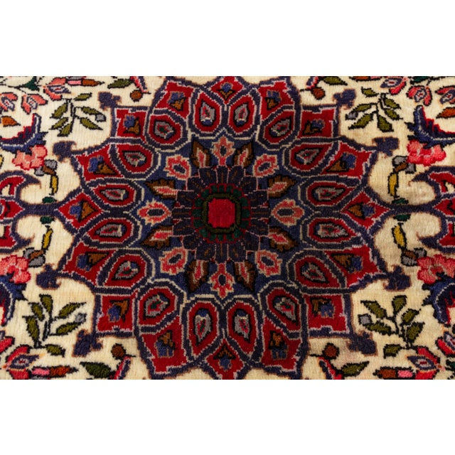 """A vintage hand-knotted Persian rug with a medallion motif. This rug measures at 2'7"""" x 3'6"""" Material: wool"""
