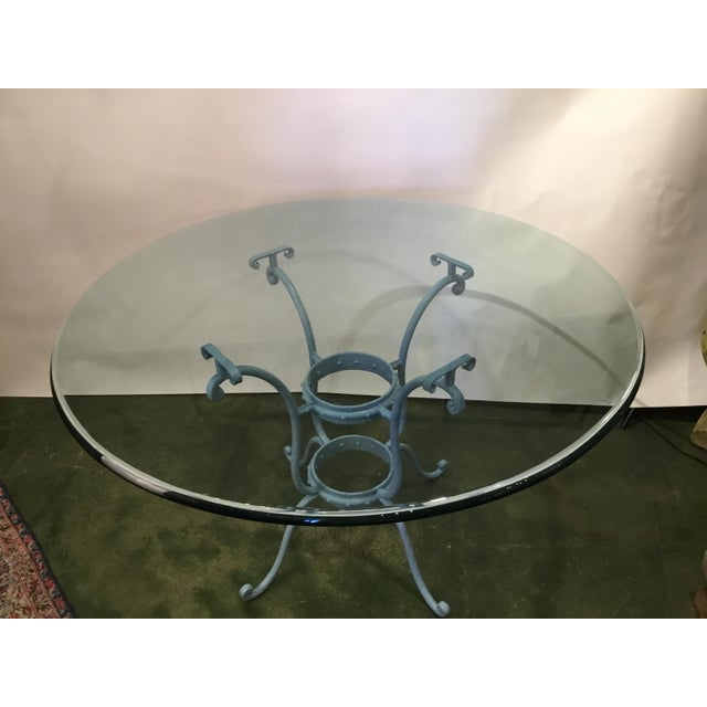 This spectacular table has classic lines and features a rounded beveled edge glass top. The glass top showcases the iron...