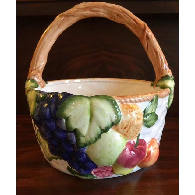 Beautiful vintage ceramic harvest basket. With a lovely white basket weave background, the front of the basket is...