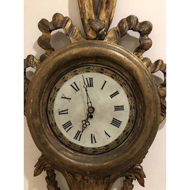 Antique French wood wall clock. Aged gold, Works perfectly.
