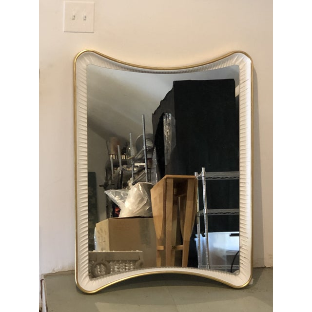 The Mirror Image Home Aged Gold Leaf and Dove White Mirror by Celerie Kemble reflects drama and beauty. Designed as a...