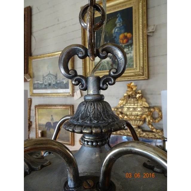A very pretty, small in size but heavy, 4 lights pewter French chandelier. The arms are metal. Beautiful detailing . Urn...