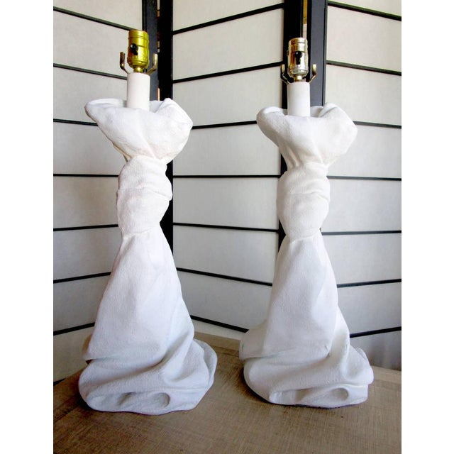 A pair of plaster lamps in the form of a drape after designer John Dickinson. Wired and in working condition.