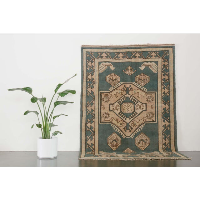 This listing is for a Turkish wool rug. The rug pattern colorways are in blue, camel, cream, brown. name: Erdemir origin:...