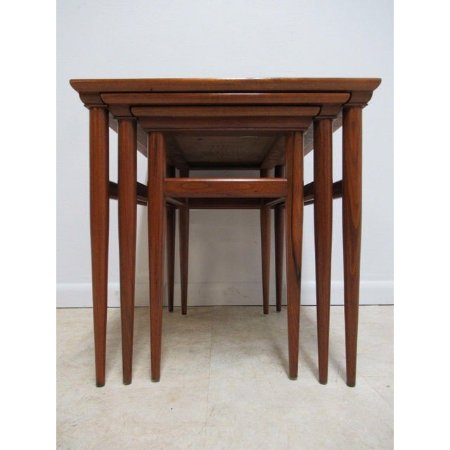 A vintage Danish Modern nesting table set. Nice shape... shows some scratches, rub marks and finish wear. Please see...