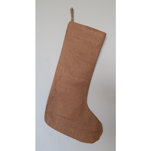 Soft Coral colored custom designed stocking made from 19th century worn velvet and detailed with a large metallic tape and...