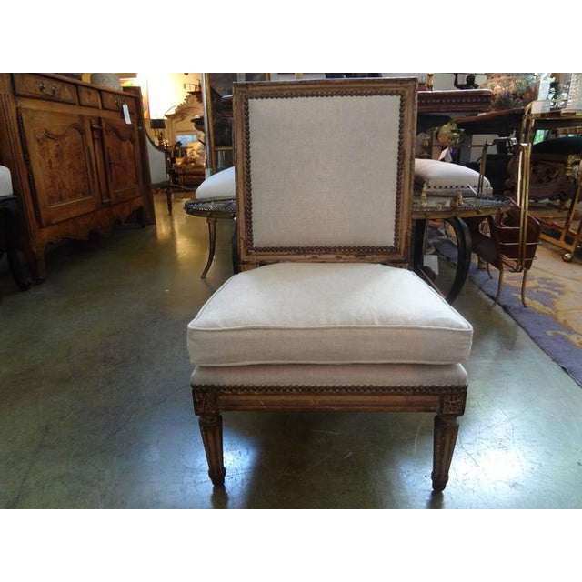 Matching pair of antique French Louis XVI style child's chairs newly upholstered in linen with brass nail head detail....