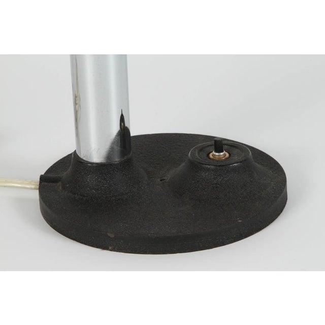 Modernist enameled bright yellow gooseneck desk lamp with black iron base. Snake desk style lamp, the tube is flexible and...