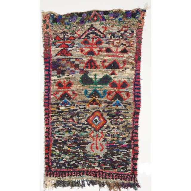 This is a vintage Moroccan Beni wool rug. The piece was handmade in the 1960s.