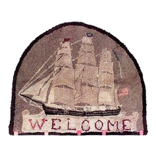 American Country style (19-20th Cent) half round hooked rug (wall hanging) with legend WELCOME and featuring a 3 masted sailingt ship flying an Americ