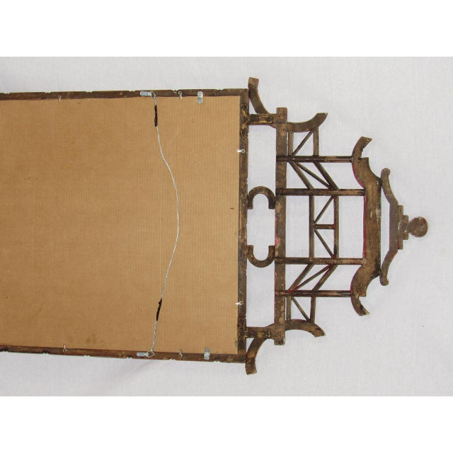 Antique English carved wood faux bamboo mirror painted in a coral red color, c.1900 In a chinoiserie style with a pagoda...