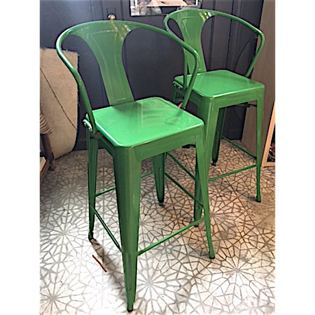 Offered is a pair of new green metal barstools in new condition. These are so fun and will be a great pop of color in your...