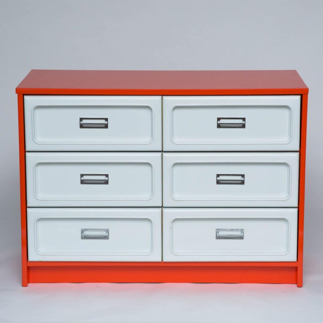 Fun three drawer dresser with 70s era plastic fronts and chrome drawer pulls. Freshly lacquered top and sides.