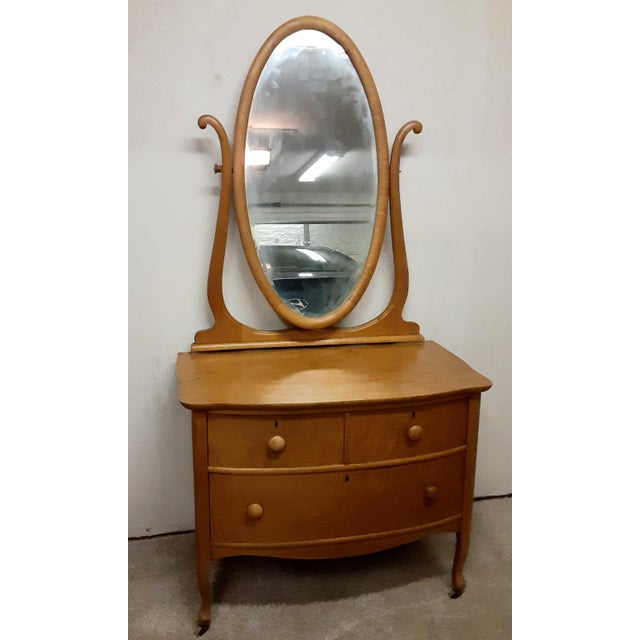 A darling little vanity dresser from the early 20th century. Made from maple wood with swivel mirror. Purchased from an...