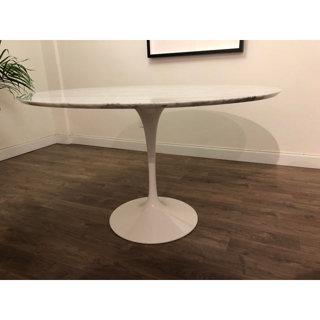 Modernist designer Eero Saarinen strove to eliminate any extraneous parts, including typical table legs, from his styles....