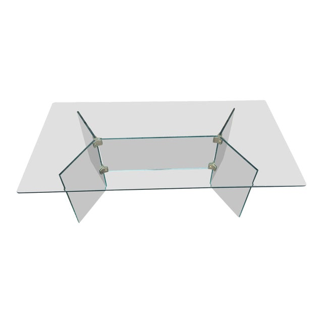 Pace glass coffee table with brass brackets For Sale