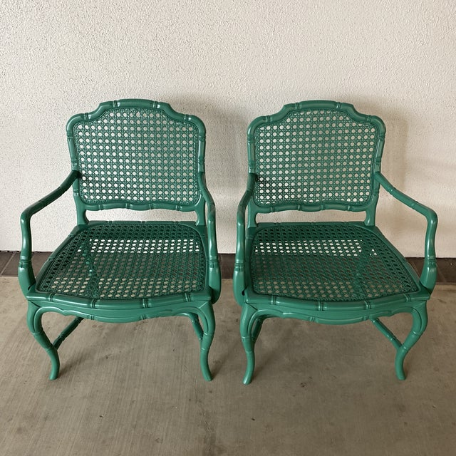 Bold green pair of lacquered cane side chairs. Fun pop of color to spice up your room.