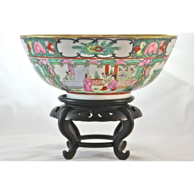 Large famille rose design console bowl with hand-painted floral and gold gilt surrounding vignettes of highly detailed...