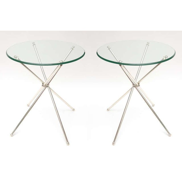 Silver plate and modernist are these chic and elegant and timeless side tables! They are from the 60's. These tripod...